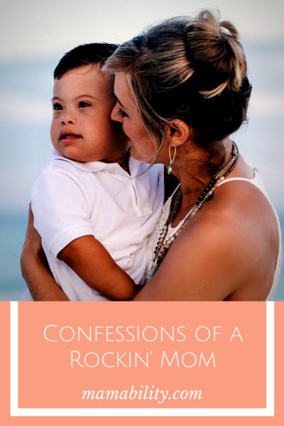 "A photo of Cara holding Everett at the beach. It's a graphic with the title ""Confessions of a Rockin' Mom"" underneath the photo."