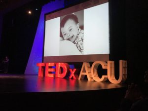 A picture of the TEDxACU stage, and Everett's photo up on the big screen!